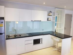 A kitchen or kitchenette at Atlantis Condominium Resort