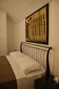 Letto o letti in una camera di B&B PugliaMeraviglia