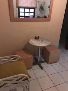 Uma área de estar em Apartment Buzios Home