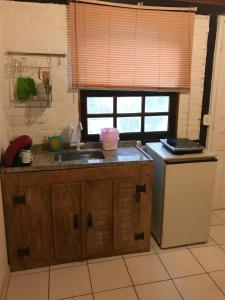 A cozinha ou cozinha compacta de Apartment Buzios Home