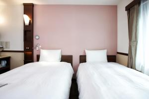 A bed or beds in a room at Toyoko Inn Seoul Gangnam