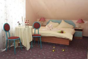 Postel nebo postele na pokoji v ubytování Hotel Hubertus