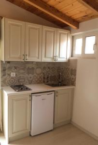 Cucina o angolo cottura di Yasemi Rooms
