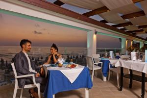 A restaurant or other place to eat at Grand Hotel Santa Maria