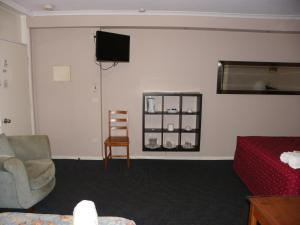 A television and/or entertainment center at Palms Motel Footscray