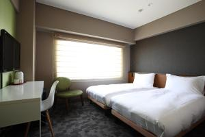 A bed or beds in a room at Agora Place Tokyo Asakusa