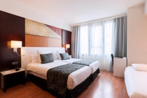 Кровать или кровати в номере Catalonia Brussels