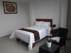 A bed or beds in a room at Gran Caral Hotel