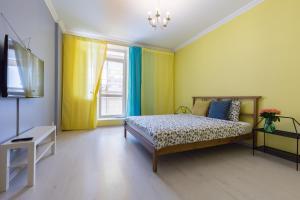 Кровать или кровати в номере Yellow Apartment on Vernosti