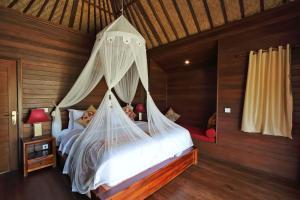 En eller flere senger på et rom på Dream Beach Cottages