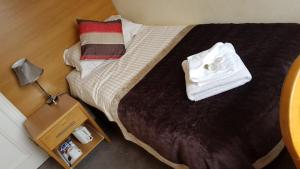 A bed or beds in a room at Belvedere Hotel
