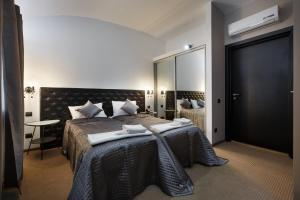 A bed or beds in a room at Tim Club Hotel