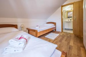 A bed or beds in a room at Hotel Srakovcic Heart of Nature