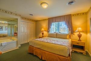 A bed or beds in a room at Vacation Village in the Berkshires
