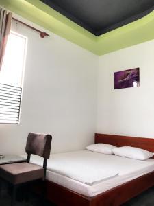 Giường trong phòng chung tại Ngoc Kha Tu 2 Hotel