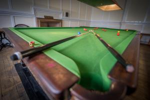 A pool table at Nethybridge Hotel
