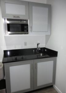 A kitchen or kitchenette at Lotus Boutique Inn and Suites