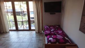 Łóżko lub łóżka w pokoju w obiekcie Willa Marco Polo