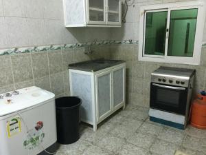 A cozinha ou cozinha compacta de Wahat Al Yarmouk Furnished Units