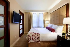 A bed or beds in a room at Millennium Knickerbocker Chicago