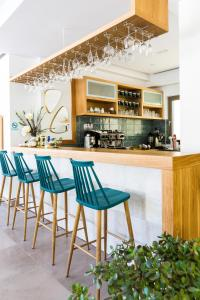 The lounge or bar area at Menta City Boutique Hotel