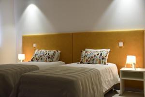 Uma cama ou camas num quarto em Varandas do Mosteiro