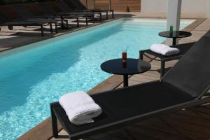 The swimming pool at or near Hotel 202