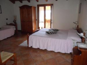 Postel nebo postele na pokoji v ubytování I Camuni