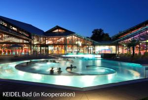 The swimming pool at or near Dorint Thermenhotel Freiburg