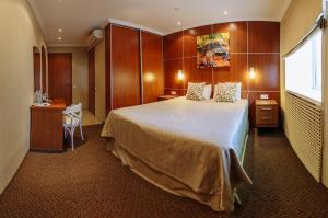 Кровать или кровати в номере Отель Скорпион