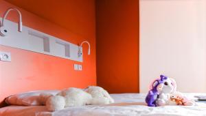 Un ou plusieurs lits dans un hébergement de l'établissement Hotel Ibis Budget Lyon Isle D'Abeau