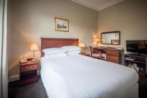 A bed or beds in a room at Nethybridge Hotel