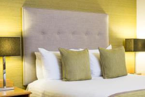 A bed or beds in a room at Lea Marston Hotel
