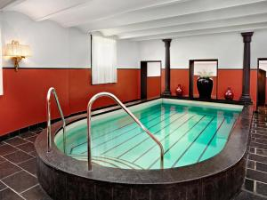 The swimming pool at or near Hotel Des Indes The Hague