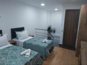 Кровать или кровати в номере Dzveli Batumi