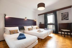 A bed or beds in a room at LV Premier Apartments Clerigos-RE2