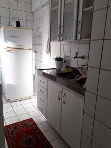 A kitchen or kitchenette at Flat Passo das Águas