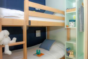 Un ou plusieurs lits superposés dans un hébergement de l'établissement Village Club Miléade Carry-le-Rouet