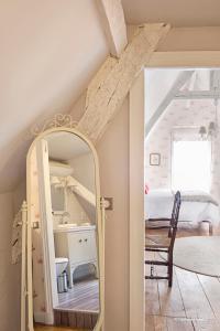 A bunk bed or bunk beds in a room at La Devinie