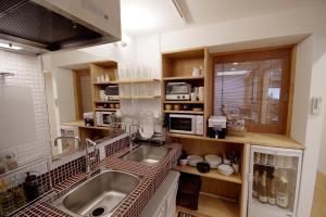 A kitchen or kitchenette at Hostel Ebi