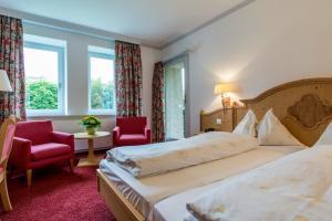 Кровать или кровати в номере Hotel Cresta