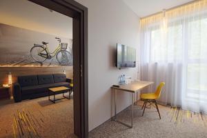 Telewizja i/lub zestaw kina domowego w obiekcie Active Hotel