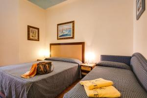 A bed or beds in a room at Aris Hotel
