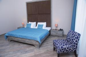 Кровать или кровати в номере Усадьба Фамилия Парк-отель