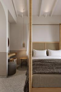 A bed or beds in a room at Casa di Pierro
