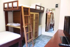 A bunk bed or bunk beds in a room at Ilha Deck Hotel