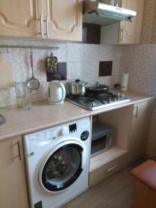 A kitchen or kitchenette at Apartment Horisont