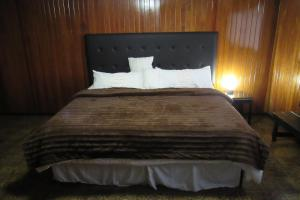 A bed or beds in a room at Cholula Rooms