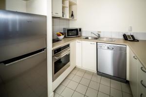A kitchen or kitchenette at Salamanca Terraces