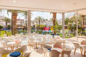 A restaurant or other place to eat at Port Denia